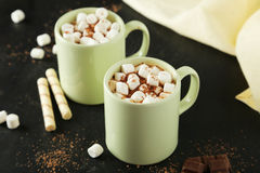 Cup of hot chocolate with marshmallows on black background Stock Image