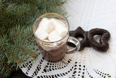 Cup of hot chocolate with marshmallows and decorative snowflake on the background of fir branches. Christmas card Royalty Free Stock Photos