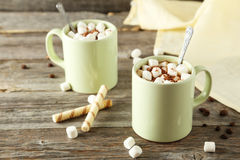 Cup of hot chocolate with marshmallows on grey wooden background Royalty Free Stock Photo