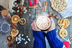 Cup of hot chocolate with marshmallows in human hands Stock Photo