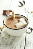 Cup of hot chocolate with marshmallows on white wooden backgroun Royalty Free Stock Photography