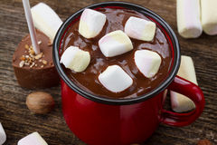 Cup of hot chocolate. Mug with hot black chocolate and marshmallows close up royalty free stock photo
