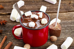 Cup of hot chocolate. Mug with hot black chocolate and white marshmallows close up Stock Photos