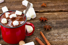 Cup of hot chocolate. Mug with hot chocolate and marshmallows on wooden table royalty free stock photo