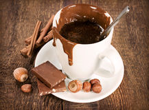 Cup of hot chocolate with nuts and cinnamon Stock Photos