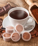 Cup of hot chocolate with pods. Stock Photos