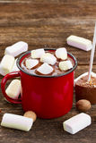 Cup of hot chocolate. Red metalic mug with hot chocolate and marshmallows royalty free stock photo