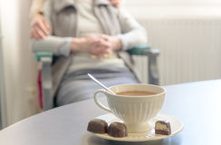 Cup of hot chocolate with senior woman Stock Image