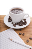 Cup of hot chocolate and sheet of paper with a pencil Stock Photography