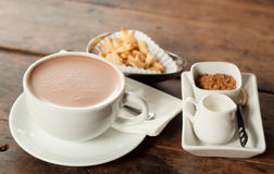 Cup of hot chocolate and snack Royalty Free Stock Photo