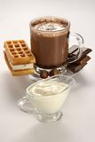 Cup of hot chocolate and wafer Stock Photos