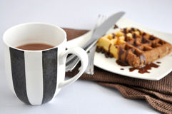 Cup of Hot Chocolate with Waffle on Background Stock Image