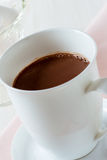 Cup of hot chocolate on a white table Royalty Free Stock Images
