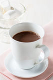 Cup of hot chocolate on a white table Royalty Free Stock Photo