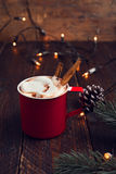 Cup of hot chocolate on wood table with rustic decoration and Christmas lights Stock Photography