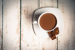 Cup of hot chocolate on wooden background Royalty Free Stock Photo