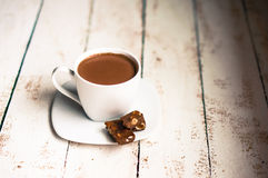 Cup of hot chocolate on wooden background Royalty Free Stock Photography