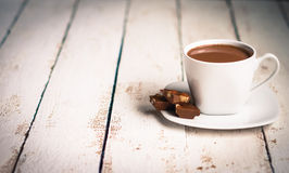 Cup of hot chocolate on wooden background Royalty Free Stock Image