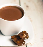 Cup of hot chocolate on wooden background Royalty Free Stock Photos
