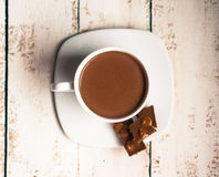 Cup of hot chocolate on wooden background Stock Image