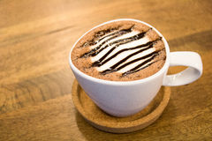 Cup of hot chocolate on wooden table Stock Image