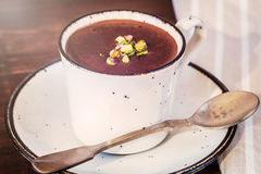 A cup of hot chocolate on a wooden textured table Royalty Free Stock Photography