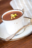 A cup of hot chocolate on a wooden textured table Stock Photo