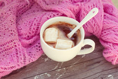 Cup of hot chocolate wrapped in a scarf Royalty Free Stock Photos