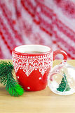Cup of hot cocao with christmas glass toy and pine Stock Images