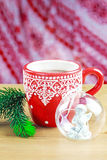 Cup of hot cocao with christmas glass toy and pine Stock Photography