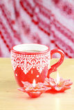 Cup of hot cocao with red poinsettia candle Stock Photography