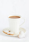 A cup of hot cocoa. And homemade white chocolate frosting cookies for valentine?s day, selective focus Stock Images