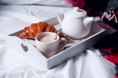 Cup of hot cocoa on chair Royalty Free Stock Image