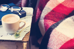 Cup of hot cocoa on chair Stock Images