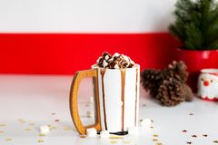 A cup of hot cocoa or chocolate with marshmallow stock photo