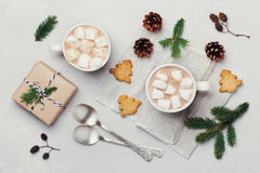 Cup of hot cocoa or chocolate with marshmallow, cookies and christmas gift on white table from above. Traditional winter drink. Stock Images