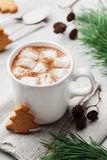 Cup of hot cocoa or chocolate with marshmallow and cookies on white table. Traditional winter drink. Stock Photo