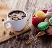 Cup of hot cocoa and french macaron. Royalty Free Stock Image