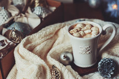 Cup of hot cocoa with marshmallow with Christmas decorations at home, Christmas tree on background Stock Photography