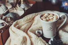 Cup of hot cocoa with marshmallow with Christmas decorations at home, Christmas tree on background Royalty Free Stock Images