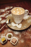 Cup hot cocoa with marshmallows, cookies on a desk with sugar powder for christmas holiday. royalty free stock photography