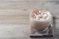 Cup of hot cocoa with marshmallows on wooden background Stock Images