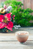 Cup of hot cocoa with marshmallows on wooden background Royalty Free Stock Image