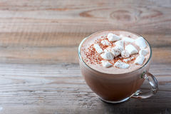 Cup of hot cocoa with marshmallows on wooden background Royalty Free Stock Images