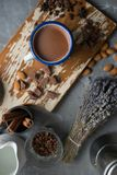 Cup of hot cocoa top view. Cup of hot cocoa, cinnamon and lavender. View from above Royalty Free Stock Photography