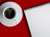 Cup of hot coffe and notebook Royalty Free Stock Images
