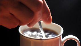 Cup of hot coffee against black background stock video