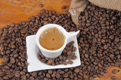 Cup of hot coffee with beans Stock Photography