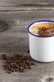 Cup with hot Coffee and Beans Stock Images
