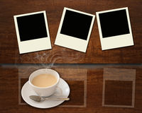 Cup of hot coffee and blank photo frame Stock Images